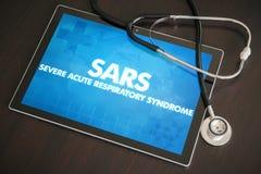 在片剂的SARS (传染病)诊断医疗概念 图库摄影