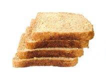 在片式上添面包 免版税图库摄影