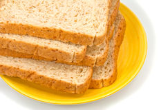 在片式上添面包 库存照片