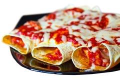 在牌照的墨西哥辣酱玉米饼馅 免版税图库摄影