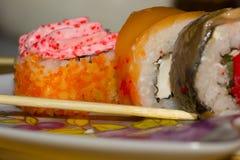 在牌照的寿司卷 免版税库存图片