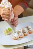 在牌照的寿司卷 库存图片