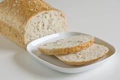 在牌照silce白色上添面包 库存照片