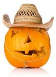 在牛仔盖帽的万圣夜南瓜 免版税库存照片