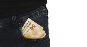在牛仔裤的土耳其钞票装在口袋里储蓄照片 库存照片