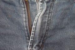 在牛仔裤的拉链 免版税库存照片