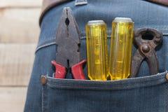 在牛仔裤矿穴的工具 免版税库存照片