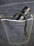 在牛仔裤矿穴的手电 图库摄影