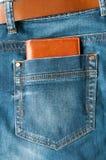 在牛仔裤矿穴的钱包 免版税库存照片