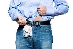 在牛仔裤货币里面的牛仔布详细资料 免版税库存图片