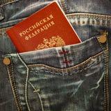 在牛仔裤口袋的俄国护照 免版税库存照片