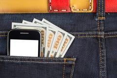 在牛仔裤口袋的手机 免版税图库摄影