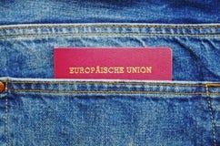 在牛仔裤口袋的护照 免版税图库摄影