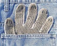 在口袋的运作的手套 库存图片
