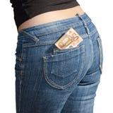 在牛仔裤的五十张欧洲钞票支持口袋 库存图片
