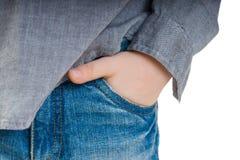 在牛仔裤的口袋的儿童的手 库存照片