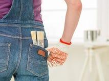 在牛仔裤的容易的工作 免版税库存图片