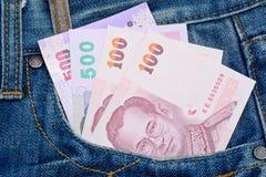 在牛仔裤的泰国钞票为金钱和企业概念装在口袋里 免版税库存图片