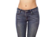 在牛仔裤的臀部 免版税库存照片