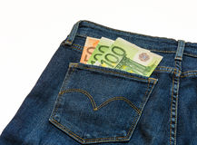 在牛仔裤零用钱欧洲钞票是 库存图片