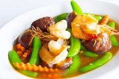 在牡蛎调味汁的混乱混杂的菜 免版税库存照片