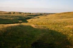 在牧场地的日出 库存照片