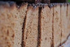 在特写镜头上添面包 免版税图库摄影