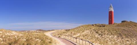在特塞尔海岛上的灯塔在荷兰 免版税图库摄影