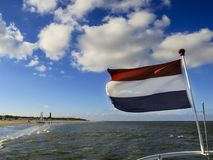 在特塞尔的荷兰旗子 库存照片