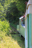 在狭窄测量仪铁路的火车在博尔若米之间和 免版税图库摄影