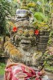 在王宫里面的石雕象,Ubud,巴厘岛,印度尼西亚 免版税库存图片