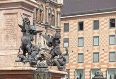 在玛丽亚专栏垫座的角落的雕象在中心广场Marienplatz的在慕尼黑,德国 图库摄影