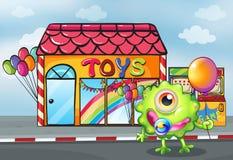 在玩具商店前面的一个妖怪 库存图片