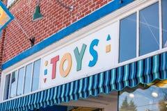 在玩具店前面的标志 图库摄影