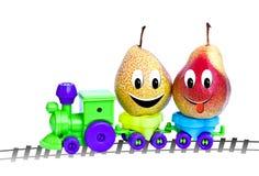 在玩具机车的两个梨 图库摄影