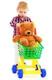 在玩具熊的卡车的小男孩骑马 免版税库存照片