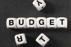 在玩具立方体的词预算 免版税图库摄影