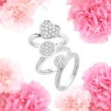 在玫瑰色背景的定婚戒指 图库摄影