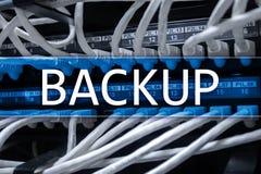 在现代服务器室背景的备用按钮 数据预防损失的措施 系统恢复 免版税库存照片