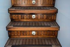 在现代游艇的木楼梯 免版税库存图片