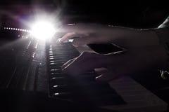 在现有量钢琴之上 免版税库存照片