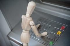 在现钞机的木字符在室外-概念撤退m 库存照片