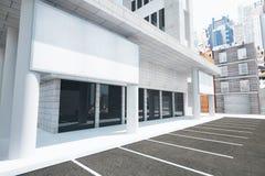在现代大厦墙壁上的空白的白色广告牌在stre的 图库摄影