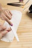 在现代的意想不到的修指甲 库存照片