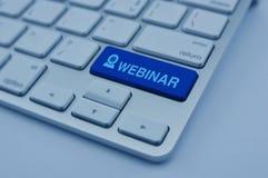 在现代键盘按钮的Webinar象,在网上研讨会 免版税库存照片