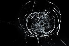 在玻璃关闭的弹孔在黑背景 免版税库存图片