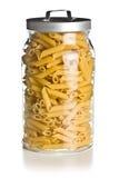 在玻璃瓶子的原始的penne意大利面食 免版税库存照片