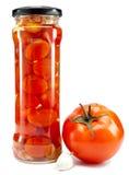 在玻璃瓶子的罐装蕃茄 库存照片