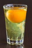 在玻璃的原始的鸡蛋 免版税库存图片