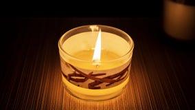 在玻璃的灼烧的有气味的蜡烛 库存图片